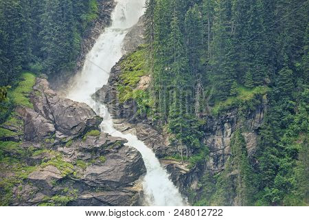 Europe Highest Waterfall. Unspoilt Nature. Beautiful Landscape With Waterfall And Spruce Forest Deep