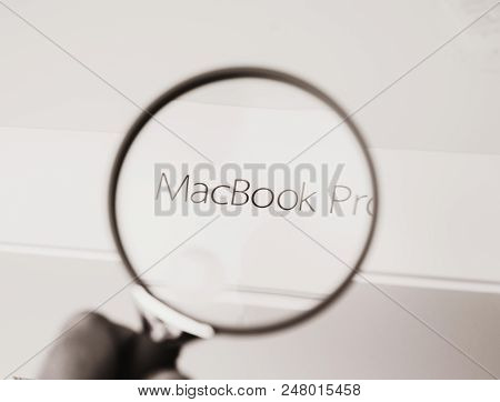 London, United Kingdom - Jan 14, 2015: Man Looking With Loupe Magnifying Glass At The Box Of The New