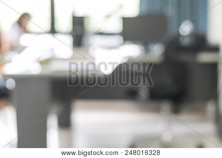 Blur Background Interior Business Office Working Space With Pc Personal Computer Screen In White Roo