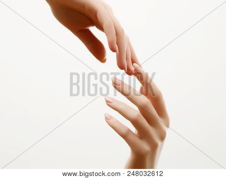 Hand Skin Care. Closeup Of Beautiful Woman Hands With Light Manicure On Nails . Cream For Hands And