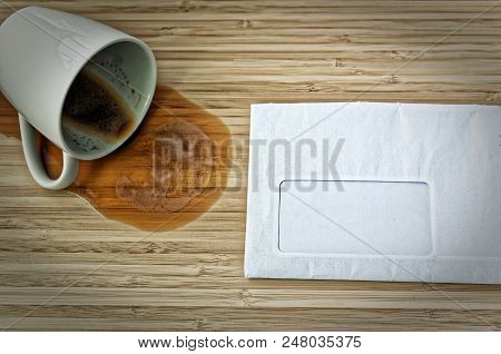 Letter With Free Text Field For Inserting A Font And A Dumped Coffee Cup