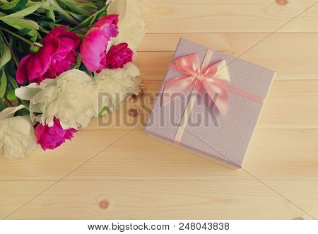 Red And White Peony Flowers And Gift Box On Wooden Background