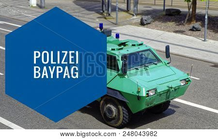 Police Green Armored Car, With The Inscription Police Baypag Police Task Law In Full Ride With Motio