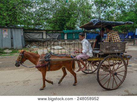 Bodhgaya, India - July 9, 2015. Horse Cart On Street In Bodhgaya, India. Bodhgaya Is The Most Revere