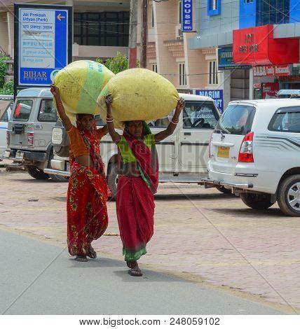 Bodhgaya, India - July 9, 2015. Local Women In Colorful Dress On Street In Bodhgaya, India. Bodhgaya