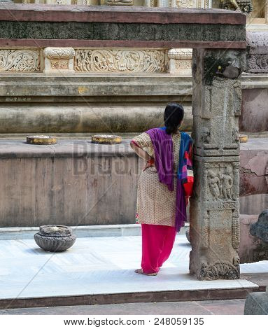 A Local Woman Standing At Mahabodhi Temple Complex. The Mahabodhi Vihar Is A Unesco World Heritage S
