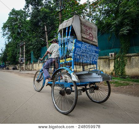 Bodhgaya, India - July 9, 2015. A Rickshaw On Street In Bodhgaya, India. Bodhgaya Is The Most Revere