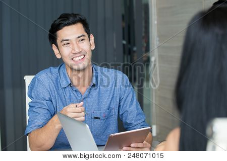 Young Asian Man Woring With Team For Creation Project, Man Working Concept,