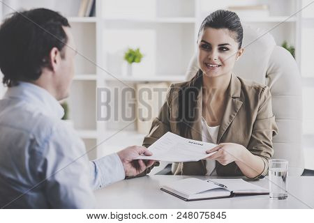 Young Smiling Businesswoman Interviewing Employee. Professional Hr Manager Sitting In Office And Tak
