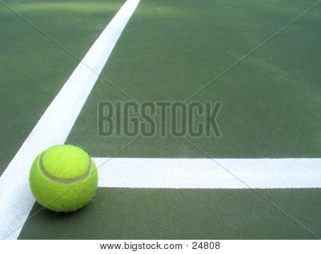 "a lone tennis ball that has rolled to a stop in the ""t"".  space for copy or additional imagery. poster"