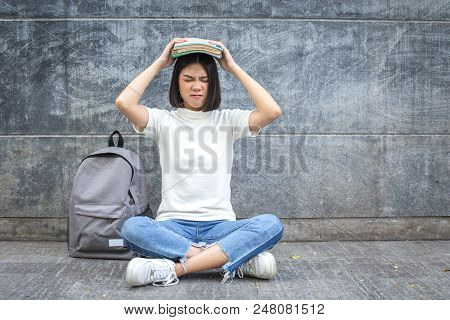 Young Asian Student With Stressed Situation. Student Serious For Exam Coming. People With Education