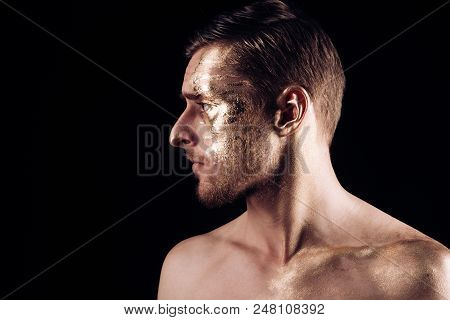 Gold Spa And Skincare Treatment. Gold Mask For Skin Of Man. Man Portrait With On Face. Gold Body Art
