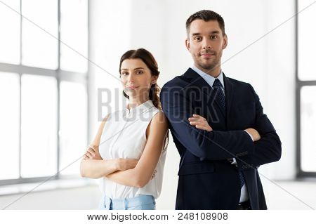 business, people and corporate concept - happy smiling businesswoman and businessman at office