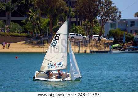 July 2, 2018 In Newport Beach, Ca:  People Riding On A Small Rental Sail Boat Called A Dinghy Boat T