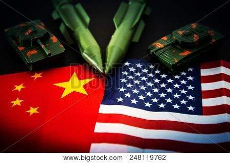 China-US trade war concept - Military facilities on the flag of China and the United States poster