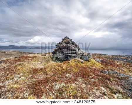 Stony Pyramid On Rocky Peak.  Mountain Peak Rising On Small Island In Norway. Stacked Pyramid At Sha
