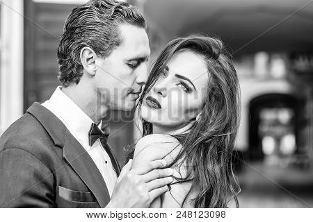 Couples In Love. Handsome Groom Holds Beautiful Bride With Passion Sensual Married Couple Outdoors O