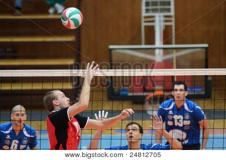 KAPOSVAR, HUNGARY - OCTOBER 29: Unidentified players in action at a Hungarian National Championship volleyball game Kaposvar (blue) vs. Szolnok (red), October 29, 2011 in Kaposvar, Hungary.