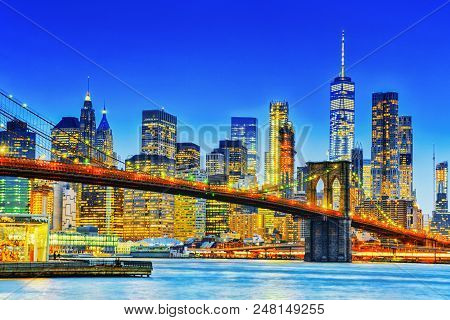 New York Night View Of The Lower Manhattan And The Brooklyn Bridge Across The East River.