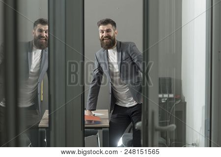 Happy Man In Casual Suit At Working Place. Bearded Man Look Out Room Door. Confident Businessman In