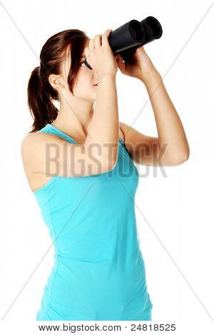 Teen student looking up through black binoculars. Isolated on white background.