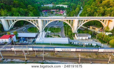 Sochi, Russia - April 27, 2018: Drone View Of The Matsesta Viaduct And Railroad With Train On The Ba