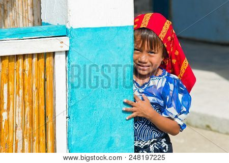 San Blas Islands, Panama - December 29, 2015: An unidentified Kuna Indian girl in native attire in the San Blas Islands.  The San Blas Islands include 365 islands and cays off the coast of Panama.