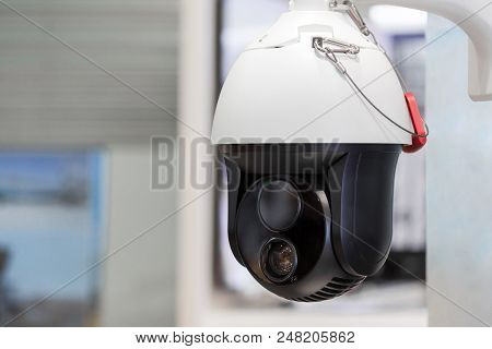Modern Motorized Surveillance Camera. Double Wide Angle Moving Lense. Self Learning Artificial Intel