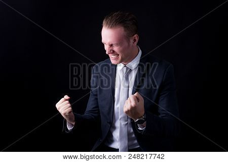 Businessman Standing On Black Background, People With Business Success Concept, Isolated On Black Ba