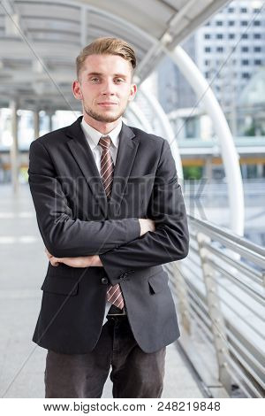 Young Hnadsome Businessman Standing In City Looking And Ready For Work. Young Businessman Have Confi