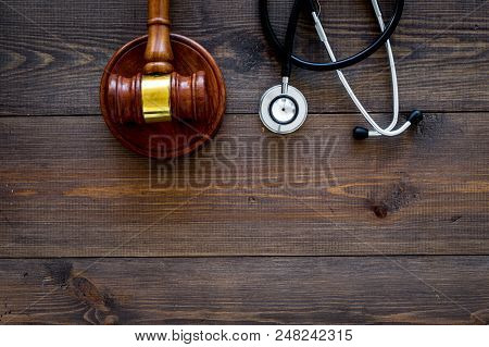 Medical Law, Health Law Concept. Gavel And Stethoscope On Dark Wooden Backgound Top View.