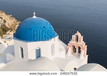 Details Of A Traditional Orthodox Blue Dome In Greece On A Very Sunny Summer Day, With The Typical B