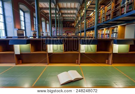Stockholm, Sweden - Jun 14, 2018: Open Book Of Reader Inside The National Library Of Sweden With His