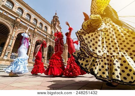Seville, Spain - May 2017: Young Women Dance Flamenco On Plaza De Espana During Famous Feria Festiva