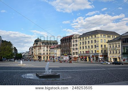 Usti Nad Labem, Czech Republic - June 30, 2018: Pavement, Historical Houses, Cars And Fountains On M
