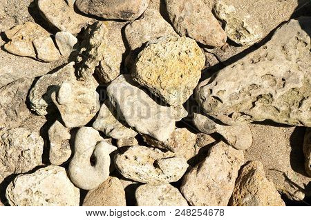 Beige Stones, Gray Stones, A Pile Of Stones Lies On The Beach, Hot Morning Stones In The Sun, Large