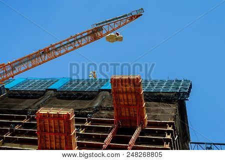 Construction Site Of A High-rise Building High-rise Crane Supplies Material
