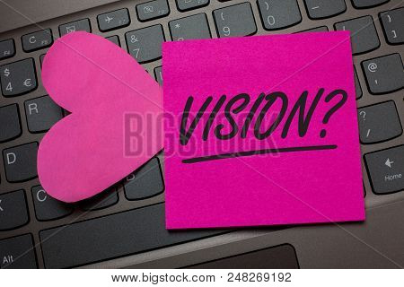 Conceptual hand writing showing Vision Question. Business photo text Company commitment describing future realistic state Keyboard grey keys pink paper love idea thought computer hart poster