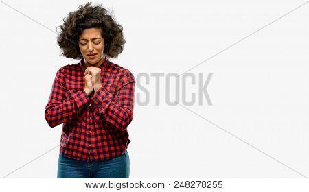 Beautiful arab woman crying depressed full of sadness expressing sad emotion