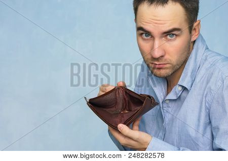 Bankruptcy - Business Person Holding An Empty Wallet. Man Showing Empty Wallet By Showing The Incons