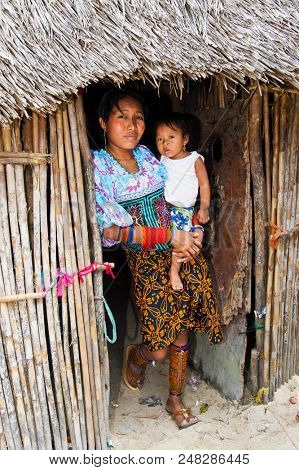 San Blas Islands, Panama - December 29, 2015: Kuna Indian woman with child in native attire in the San Blas Islands. The San Blas Islands include 365 islands and cays off the coast of Panama.