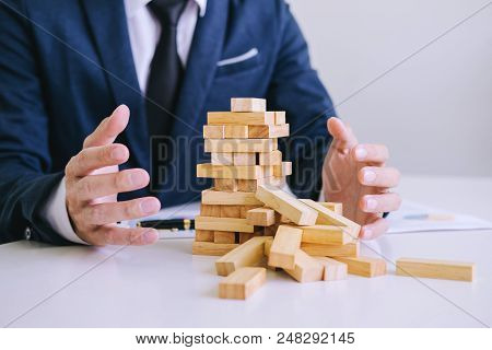 Alternative Risk Concept, Plan And Strategy In Business Protect With Balance Wooden Stack With Hand