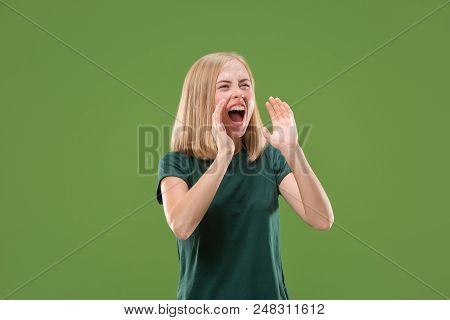 Screaming. Crying Emotional Angry Woman Screaming On Green Studio Background. Emotional, Young Face.