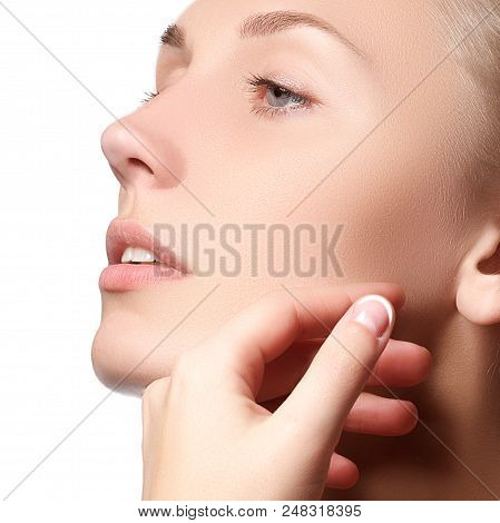 Beautiful Face Of Young Woman With Clean Fresh Skin. Portrait Of Beautiful Young Woman With Beautifu