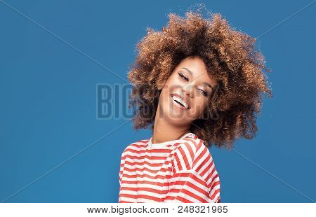 Smiling Afro Woman In Sailor Style Shirt.