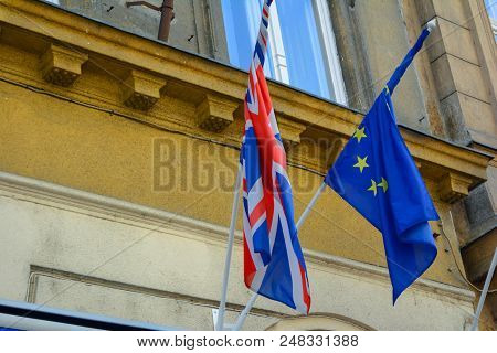 Eu And Uk Flags Coalition Together. European Union And United Kingdom Flags Next To Each Other