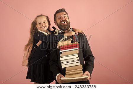 School Time. Girl In School Uniform And Bearded Man In Suit. Kid Hugs Her Dad Holding Pile Of Books.