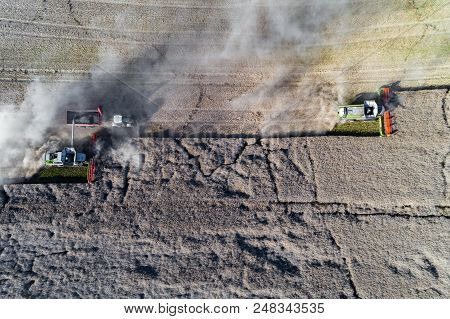 Aerial View On The Harvesters Working On The Field