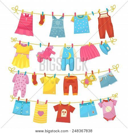 Children Clothes On Rope. Kids Bright Clothing Washed Is Hung Along The Line To Dry, Using Clothes P