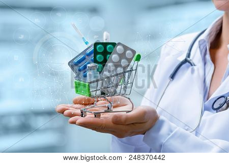 Pharmacist Shows A Shopping Cart With Medications On Blurred Background.